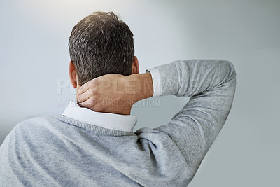 Buy stock photo Rearview shot of a businessman holding his neck in pain