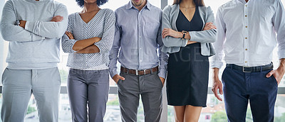 Buy stock photo Shot of an unrecognizable group of businesspeople standing in an office