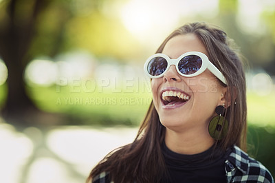 Buy stock photo Cropped shot of an attractive young woman spending the day outdoors