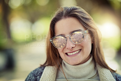 Buy stock photo Cropped portrait of an attractive young woman spending a day in the park