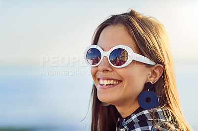 Buy stock photo Cropped shot of an attractive young woman spending a day by the ocean