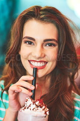 Buy stock photo Shot of a beautiful young woman drinking a milkshake in a diner