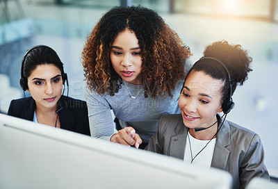 Buy stock photo Shot of a young woman assisting her colleagues in a call centre