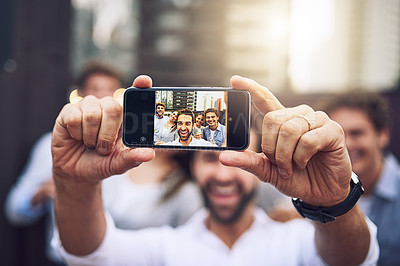 Buy stock photo Portrait of a group of cheerful young work colleagues taking a self portrait together outside during the day