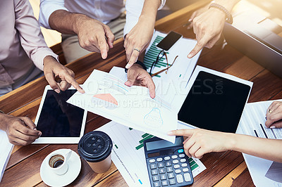 Buy stock photo Closeup shot of a group of unrecognizable businesspeople going through paperwork outdoors