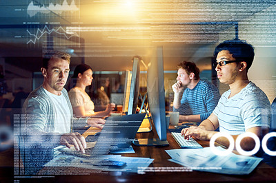 Buy stock photo Shot of a group of young people using computers with virtual screens during a late night at work