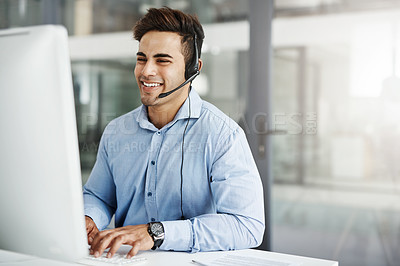 Buy stock photo Shot of a handsome young man working in a call center