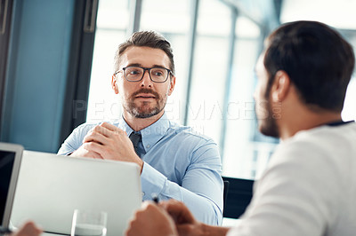 Buy stock photo Shot of two businessmen having a meeting in a modern office