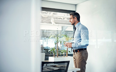 Buy stock photo Shot of mature businessman leading a meeting in a modern office