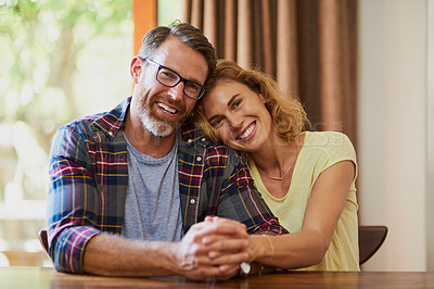 Buy stock photo Cropped shot of a mature married couple being affectionate at home