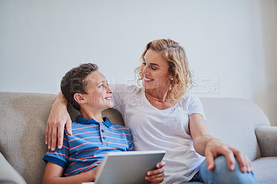 Buy stock photo Cropped shot of a mother and her son using a laptop together on the sofa at home