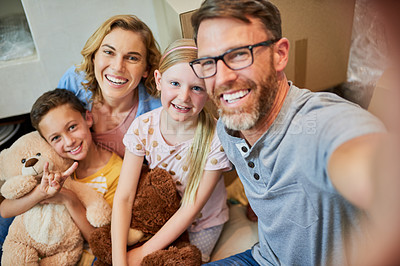 Buy stock photo Cropped shot of an affectionate family taking a selfie together at home