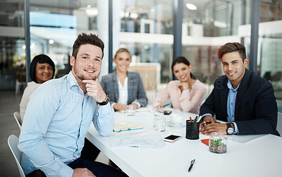 Buy stock photo Cropped portrait of a group of businesspeople sitting in their office boardroom during a meeting