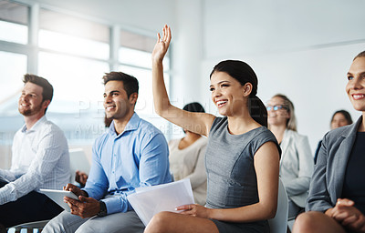 Buy stock photo Cropped shot of an attractive young businesswoman raising her hand during a seminar