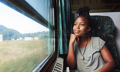 Buy stock photo Cropped shot of a young attractive woman traveling by train