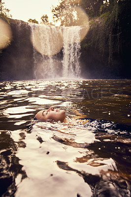 Buy stock photo Shot of a young woman swimming in a lake