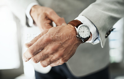 Buy stock photo Closeup of an unrecognizable businessman attaching a watch to his wrist at home during the day
