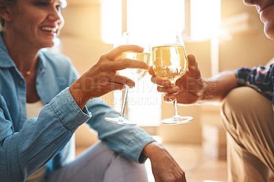 Buy stock photo Shot of a happy mature couple toasting with wine on moving day