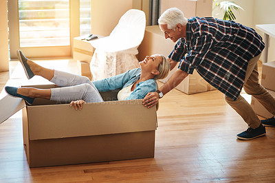 Buy stock photo Shot of a happy mature couple having fun on moving day