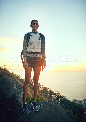 Buy stock photo Portrait of a young woman out on a hike through the mountains