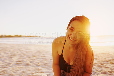 Buy stock photo Portrait of a happy young woman spending a day at the beach