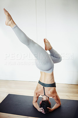 Buy stock photo Rearview shot of an unrecognizable woman doing yoga at home