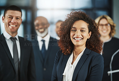 Buy stock photo Portrait of a team of confident business executives standing together in a modern office