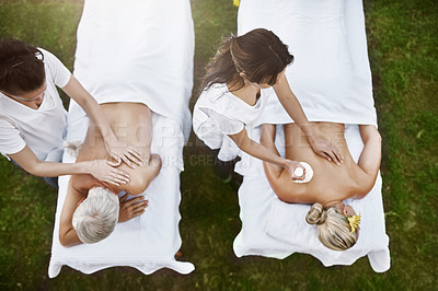 Buy stock photo High angle shot of a middle aged couple having a relaxing massage together at a spa during the day