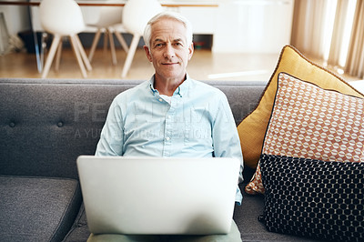 Buy stock photo Cropped shot of a senior man relaxing and using a laptop on the sofa at home