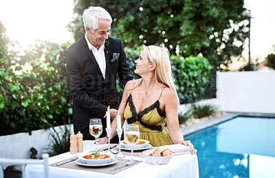 Buy stock photo Shot of a mature couple out on a romantic date
