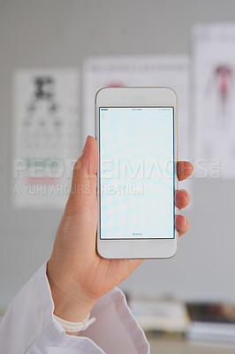 Buy stock photo High angle shot of an unrecognizable female doctor sending a text while working in the hospital
