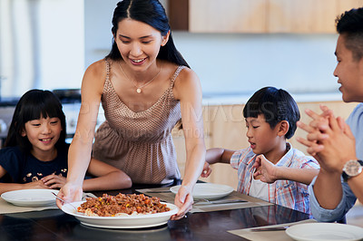 Buy stock photo Shot of a family enjoying a meal together at home