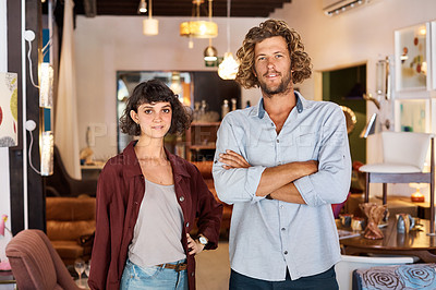 Buy stock photo Shot of two colleagues standing in a furniture store