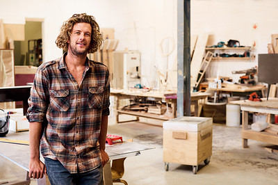 Buy stock photo Portrait of a handsome young man standing in a furniture manufacturing workshop