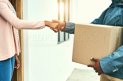Buy stock photo Closeup shot of a courier shaking hands with a customer while making a delivery