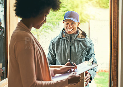 Buy stock photo Shot of a woman signing for her delivery from the courier