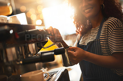 Buy stock photo Closeup shot of a barista operating a coffee machine in a cafe
