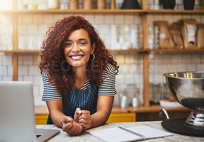 Buy stock photo Cropped portrait of an attractive young woman working in her coffee shop