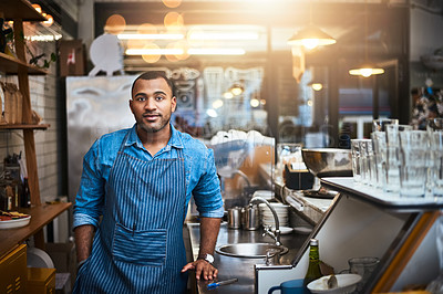 Buy stock photo Cropped portrait of a handsome young man working in his coffee shop