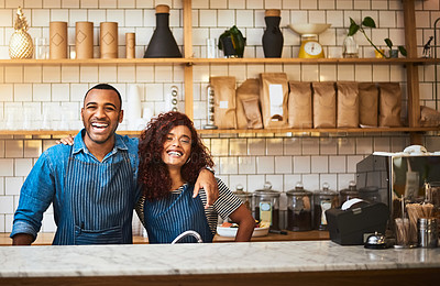 Buy stock photo Cropped portrait of an affectionate young couple standing in their coffee shop