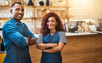 Buy stock photo Cropped portrait of an affectionate young couple standing with their arms crossed in their coffee shop