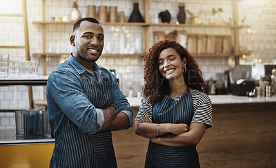Buy stock photo Portrait of two young entrepreneurs standing in their cafe