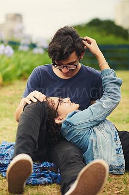 Buy stock photo Cropped shot of a teenage couple being affectionate outdoors