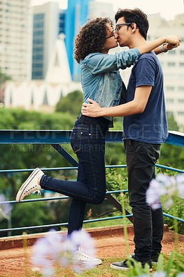 Buy stock photo Shot of a teenage couple kissing outdoors