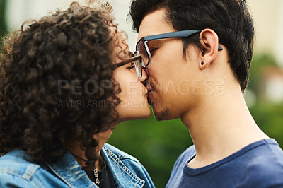 Buy stock photo Cropped shot of a teenage couple kissing outdoors