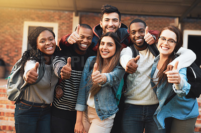 Buy stock photo Portrait of a group of students giving thumbs up together on campus