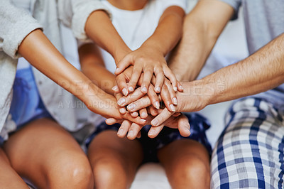 Buy stock photo Closeup shot of an unrecognizable family of three with their hands in a pile