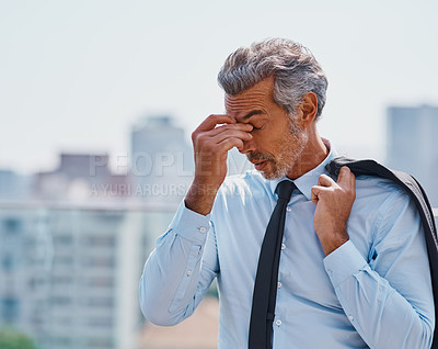 Buy stock photo Cropped shot of a mature corporate businessman experiencing a headache outside