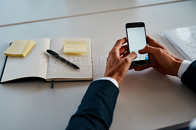 Buy stock photo Cropped shot of an unrecognizable corporate businessman using a cellphone in the office