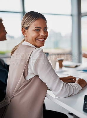 Buy stock photo Cropped shot of corporate businesswoman looking back while in a meeting in the boardroom